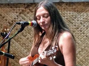 Woman playing uke at Pono